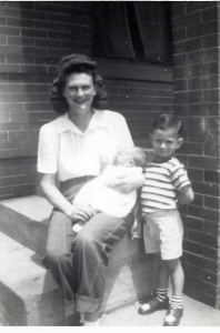 My mom, Geneva, holding Jackie and me in my shorts.